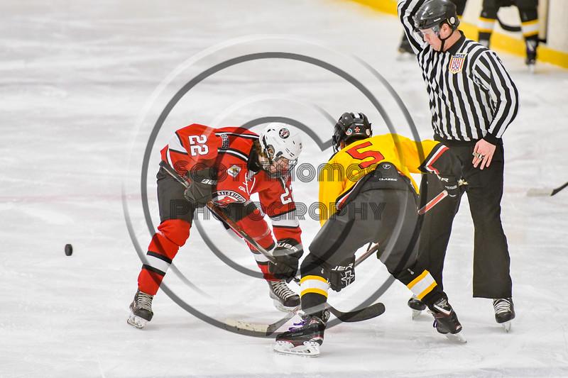 Baldwinsville Bees Mark Monaco (22) wins a face-off against Ontario Storm Caeden Goodnough (5) in NYSPHSAA Section III Boys Ice hockey action at Haldane Memorial Arena in Pulaski, New York on Thursday, December 20, 2018. Baldwinsville won 12-0.