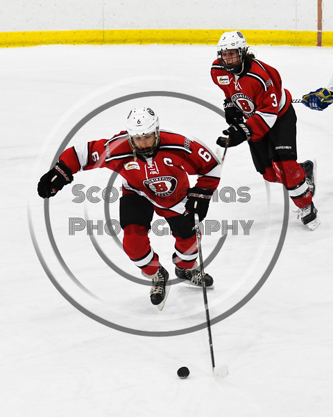 Baldwinsville Bees Michael Carni (6) skating with the puck against the West Genesee Wildcats in NYSPHSAA Section III Boys Ice hockey action at Shove Park in Camillus, New York on Tuesday, January 29, 2019. West Genesee won 5-1.