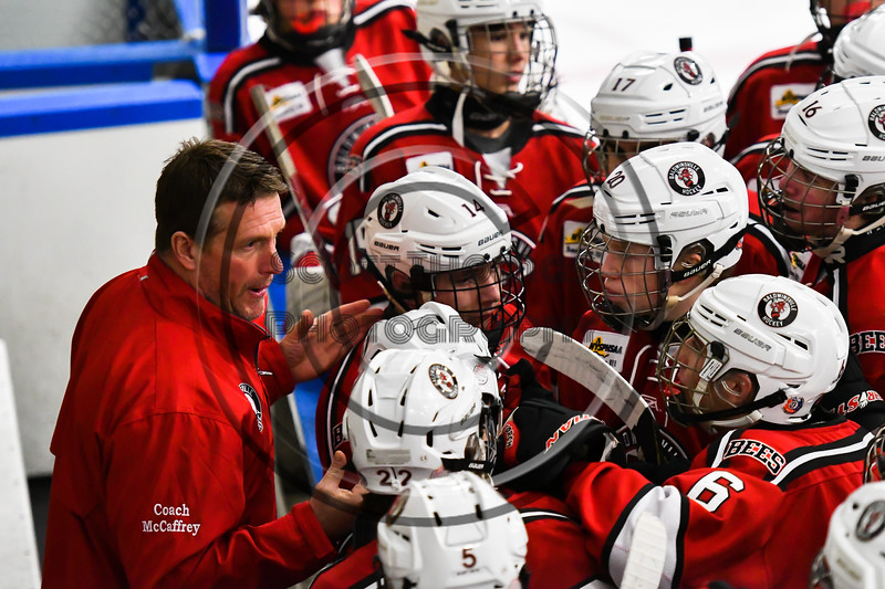 Baldwinsville Bees Assistant Coach Glenn McCaffrey preps his players before the second period against the West Genesee Wildcats in a NYSPHSAA Section III Boys Ice hockey game at Shove Park in Camillus, New York on Tuesday, January 29, 2019. West Genesee won 5-1.