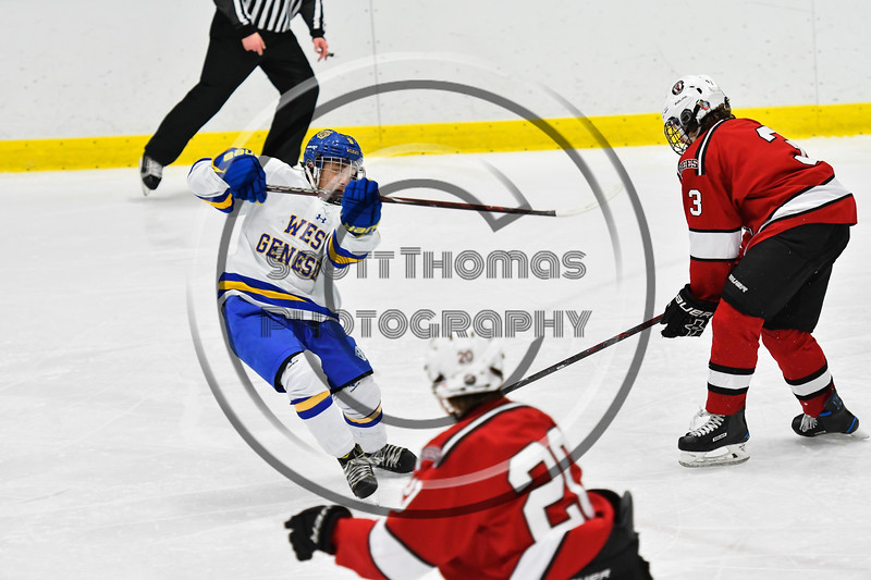 West Genesee Wildcats Joe McLaughlin (9) after shooting the puck at the Baldwinsville Bees net in NYSPHSAA Section III Boys Ice hockey action at Shove Park in Camillus, New York on Tuesday, January 29, 2019. West Genesee won 5-1.