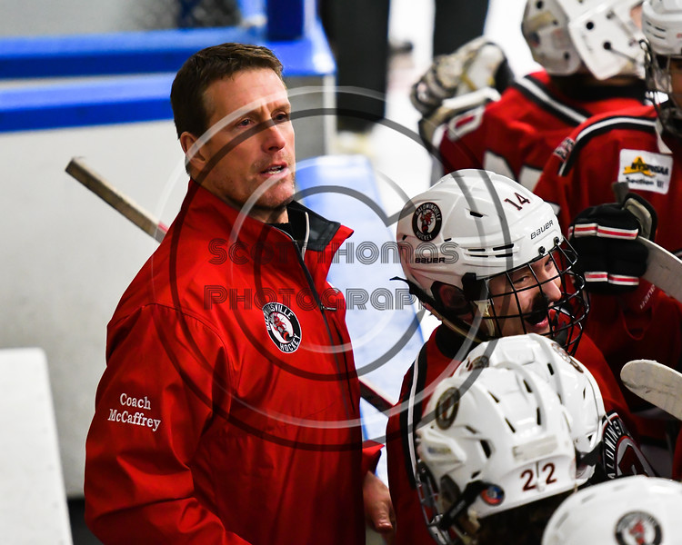 Baldwinsville Bees Assistant Coach Glenn McCaffrey on the bench before the Bees start the second period against the West Genesee Wildcats in a NYSPHSAA Section III Boys Ice hockey game at Shove Park in Camillus, New York on Tuesday, January 29, 2019. West Genesee won 5-1.