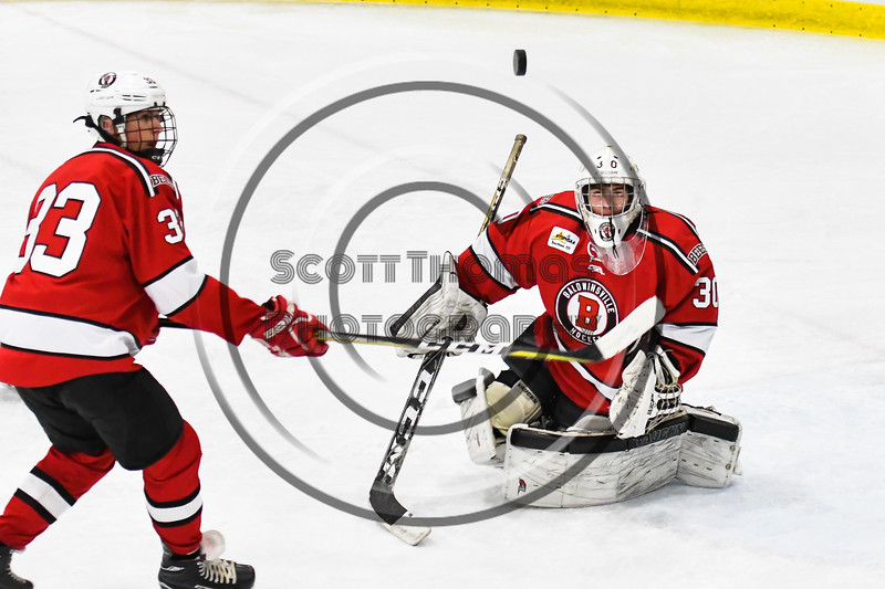 Baldwinsville Bees goalie Bradley O'Neill (30) makes a save against the West Genesee Wildcats in NYSPHSAA Section III Boys Ice hockey action at Shove Park in Camillus, New York on Tuesday, January 29, 2019. West Genesee won 5-1.