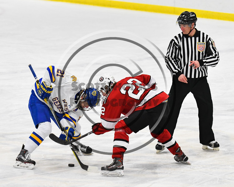 Baldwinsville Bees Mark Monaco (22) faced off against West Genesee Wildcats Jimmy Bergan (21) to start a NYSPHSAA Section III Boys Ice hockey game at Shove Park in Camillus, New York on Tuesday, January 29, 2019. West Genesee won 5-1.