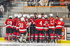 Baldwinsville Bees players huddle up at the bench with their coaches before the start of the third period against the Rome Free Academy Black Knights in a NYSPHSAA Section III Boys Ice hockey playoff game at John F. Kennedy Civic Arena in Rome, New York on Friday, February 15, 2019. Baldwinsville won 5-3.
