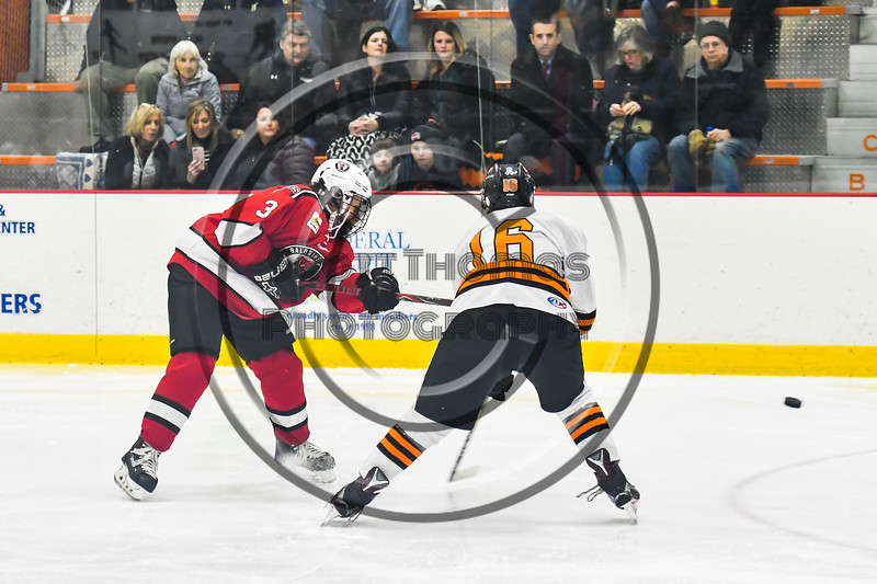 Baldwinsville Bees Ryan Muscatello (3) fires the puck past Rome Free Academy Black Knights Aaron Simons (16) in NYSPHSAA Section III Boys Ice hockey playoff action at John F. Kennedy Civic Arena in Rome, New York on Friday, February 15, 2019. Baldwinsville won 5-3.