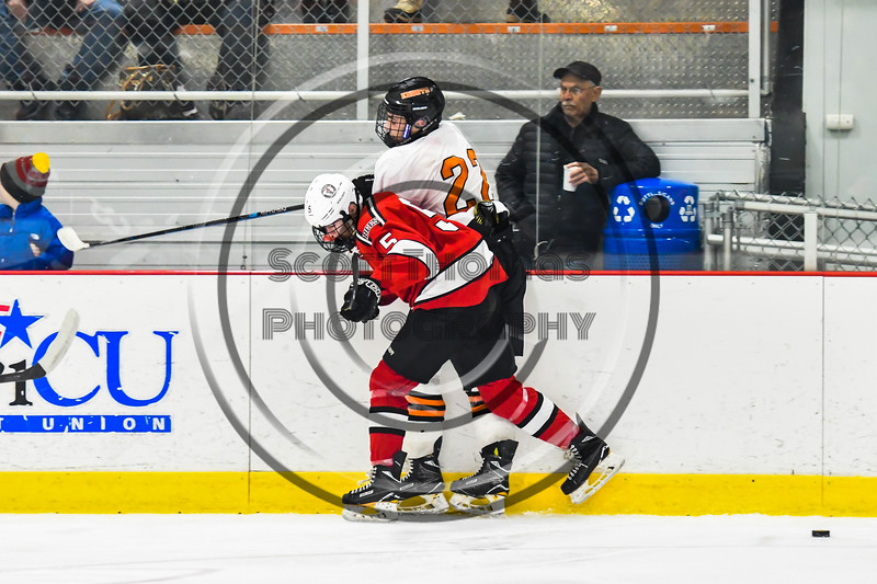 Baldwinsville Bees Alexander Pompo (5) checks the puck away from Rome Free Academy Black Knights Daniel Mecca (22) in NYSPHSAA Section III Boys Ice hockey playoff action at John F. Kennedy Civic Arena in Rome, New York on Friday, February 15, 2019. Baldwinsville won 5-3.