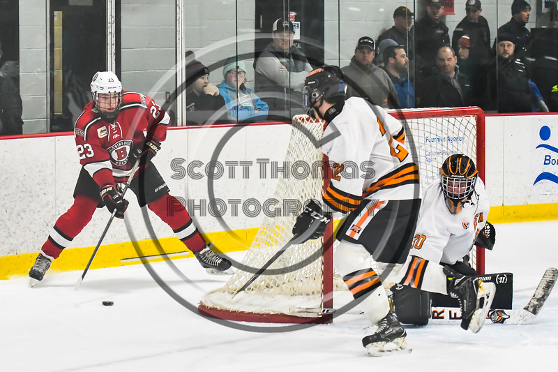 Baldwinsville Bees Braden Lynch (23) looking to make a play against the Rome Free Academy Black Knights in NYSPHSAA Section III Boys Ice hockey playoff action at John F. Kennedy Civic Arena in Rome, New York on Friday, February 15, 2019. Baldwinsville won 5-3.