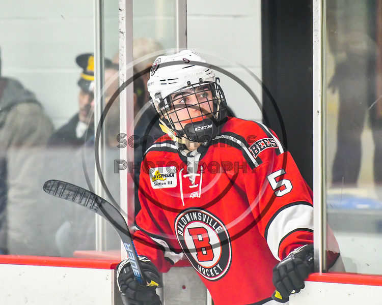 Baldwinsville Bees Alexander Pompo (5) waiting to get on the ice for the third period against the Rome Free Academy Black Knights in a NYSPHSAA Section III Boys Ice hockey playoff game at John F. Kennedy Civic Arena in Rome, New York on Friday, February 15, 2019. Baldwinsville won 5-3.