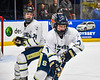 Skaneateles Lakers Thomas Coyne (7) with the puck against the Cortland-Homer Golden Eagles in the Section III, Division II Boys Ice Hockey Championship game at the War Memorial Arena in Syracuse, New York on Monday, February 25, 2019.  Skaneateles Lakers won 4-1.