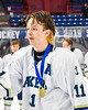 Skaneateles Lakers Ryan Gick (11) receives his Section III, Division II Boys Ice Hockey Championship medallion at the War Memorial Arena in Syracuse, New York on Monday, February 25, 2019.