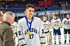 Skaneateles Lakers Cole Heintz (17) receives his Section III, Division II Boys Ice Hockey Championship medallion at the War Memorial Arena in Syracuse, New York on Monday, February 25, 2019.