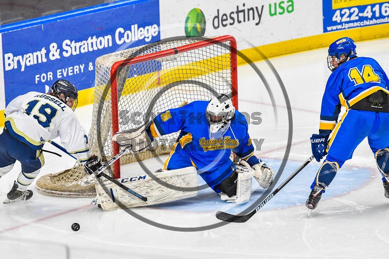 Cortland-Homer Golden Eagles goalie Brandon Ludwig (35) makes a save against the Skaneateles Lakers in the Section III, Division II Boys Ice Hockey Championship game at the War Memorial Arena in Syracuse, New York on Monday, February 25, 2019.  Skaneateles Lakers won 4-1.