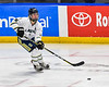 Skaneateles Lakers Bauer Morrissey (5) passes the puck against the Cortland-Homer Golden Eagles in the Section III, Division II Boys Ice Hockey Championship game at the War Memorial Arena in Syracuse, New York on Monday, February 25, 2019.  Skaneateles Lakers won 4-1.