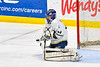 Skaneateles Lakers goalie Adam Casper (44) makes a save against the Cortland-Homer Golden Eagles in the Section III, Division II Boys Ice Hockey Championship game at the War Memorial Arena in Syracuse, New York on Monday, February 25, 2019.  Skaneateles Lakers won 4-1.