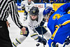 Skaneateles Lakers Garrett Krieger (12) facing off against Cortland-Homer Golden Eagles Nicholas Djafari (2) in the Section III, Division II Boys Ice Hockey Championship game at the War Memorial Arena in Syracuse, New York on Monday, February 25, 2019.  Skaneateles Lakers won 4-1.