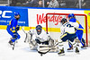 Skaneateles Lakers defenders Cam Lowe (2) and goalie Adam Casper (44) keep the puck out of the net against the Cortland-Homer Golden Eagles in the Section III, Division II Boys Ice Hockey Championship game at the War Memorial Arena in Syracuse, New York on Monday, February 25, 2019.  Skaneateles Lakers won 4-1.