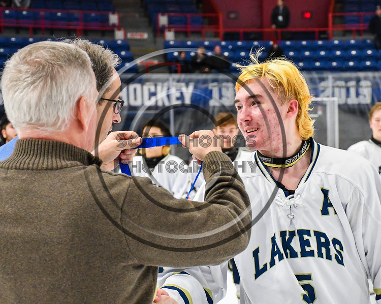Skaneateles Lakers Bauer Morrissey (5) receives his Section III, Division II Boys Ice Hockey Championship medallion at the War Memorial Arena in Syracuse, New York on Monday, February 25, 2019.