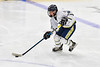 Skaneateles Lakers Charlie Russell (19) carrying the puck against the Cortland-Homer Golden Eagles in the Section III, Division II Boys Ice Hockey Championship game at the War Memorial Arena in Syracuse, New York on Monday, February 25, 2019.  Skaneateles Lakers won 4-1.