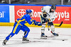 Skaneateles Lakers Owen Van Holtz (15) is checked by Cortland-Homer Golden Eagles Jed Brazo (23) in the Section III, Division II Boys Ice Hockey Championship game at the War Memorial Arena in Syracuse, New York on Monday, February 25, 2019.  Skaneateles Lakers won 4-1.