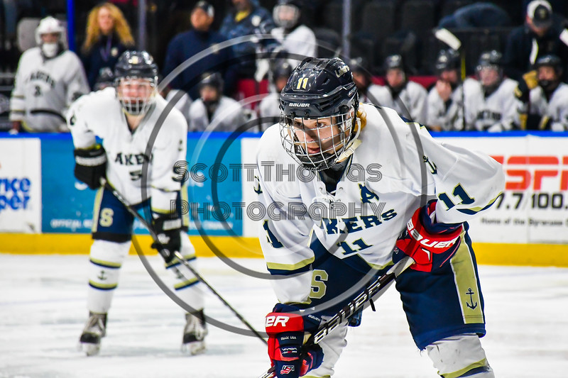 Skaneateles Lakers Ryan Gick (11) before a face-off against the Cortland-Homer Golden Eagles in the Section III, Division II Boys Ice Hockey Championship game at the War Memorial Arena in Syracuse, New York on Monday, February 25, 2019.  Skaneateles Lakers won 4-1.