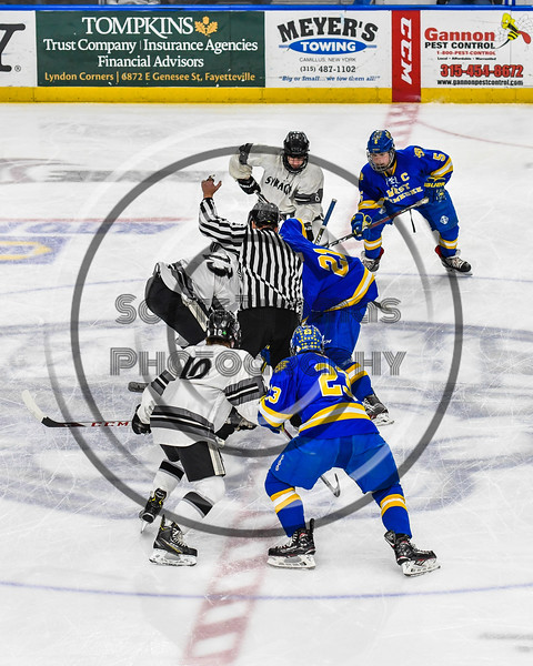 Syracuse Cougars and West Genesee Wildcats face-off to start the Section III, Division I Boys Ice Hockey Championship game at the War Memorial Arena in Syracuse, New York on Monday, February 25, 2019.  Syracuse won 3-2 in 4OT.