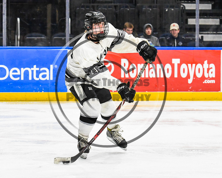 Syracuse Cougars Jack Grooms (24) looking to make a pass against the West Genesee Wildcats in the Section III, Division I Boys Ice Hockey Championship game at the War Memorial Arena in Syracuse, New York on Monday, February 25, 2019.  Syracuse won 3-2 in 4OT.