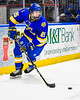 West Genesee Wildcats Chris Kleberg (25) with the puck against the Syracuse Cougars in the Section III, Division I Boys Ice Hockey Championship game at the War Memorial Arena in Syracuse, New York on Monday, February 25, 2019.  Syracuse won 3-2 in 4OT.