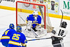 West Genesee Wildcats goalie Chris Wells (31) makes a save against Syracuse Cougars Skariwate Papineau (18) in the Section III, Division I Boys Ice Hockey Championship game at the War Memorial Arena in Syracuse, New York on Monday, February 25, 2019.  Syracuse won 3-2 in 4OT.