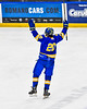 West Genesee Wildcats Jack Miller (20) celebrates his goal against the Syracuse Cougars in the Section III, Division I Boys Ice Hockey Championship game at the War Memorial Arena in Syracuse, New York on Monday, February 25, 2019.  Syracuse won 3-2 in 4OT.
