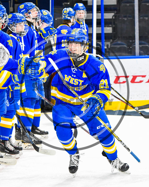 West Genesee Wildcats Jimmy Bergan (21) being introduced before playing the Syracuse Cougars in the Section III, Division I Boys Ice Hockey Championship game at the War Memorial Arena in Syracuse, New York on Monday, February 25, 2019.