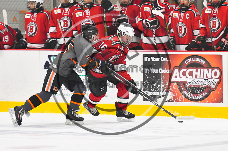 Baldwinsville Bees Luke Hoskin (16) is being defended by Rome Free Academy Black Knights Eli Dormino (25) in NYSPHSAA Section III Boys Ice hockey action at John F. Kennedy Civic Arena in Rome, New York on Tuesday, January 15, 2019. Rome Free Academy won 4-1.