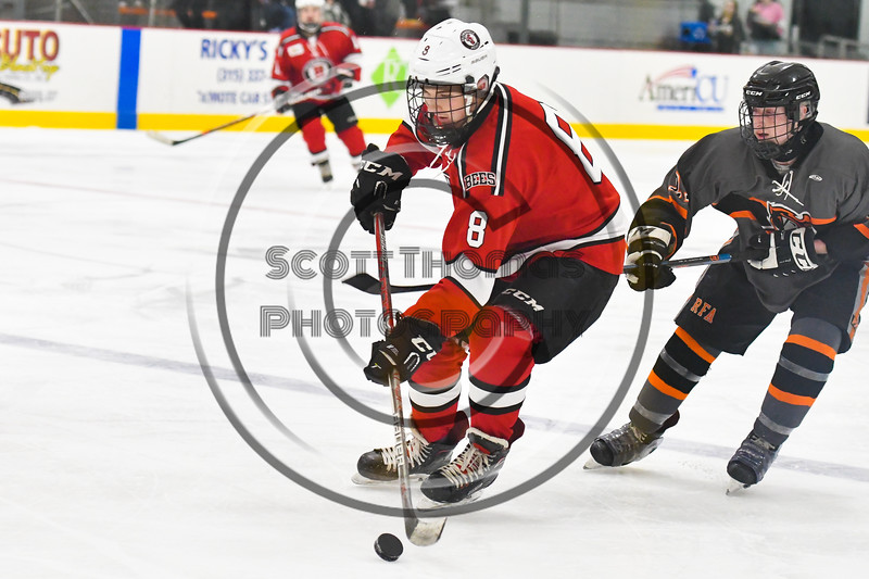 Baldwinsville Bees Parker Schroeder (8) skating with the puck against the Rome Free Academy Black Knights in NYSPHSAA Section III Boys Ice hockey action at John F. Kennedy Civic Arena in Rome, New York on Tuesday, January 15, 2019. Rome Free Academy won 4-1.