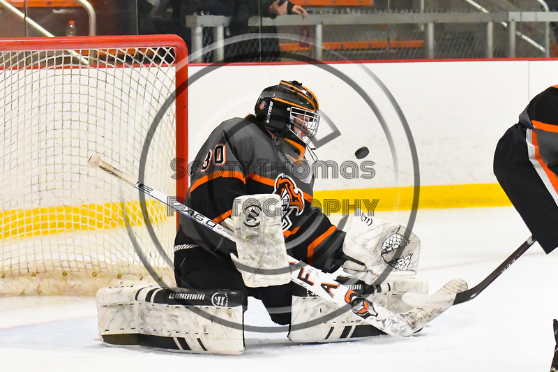 Rome Free Academy Black Knights goalie Isaiah Nebush (30) makes a save against the Baldwinsville Bees in NYSPHSAA Section III Boys Ice hockey action at John F. Kennedy Civic Arena in Rome, New York on Tuesday, January 15, 2019. Rome Free Academy won 4-1.