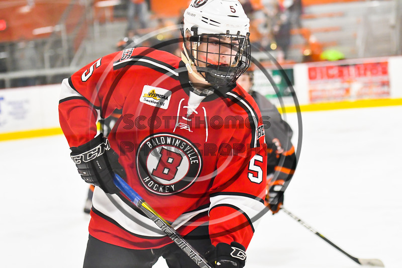 Baldwinsville Bees Alexander Pompo (5) playing against the Rome Free Academy Black Knights in NYSPHSAA Section III Boys Ice hockey action at John F. Kennedy Civic Arena in Rome, New York on Tuesday, January 15, 2019. Rome Free Academy won 4-1.