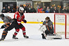 Rome Free Academy Black Knights goalie Isaiah Nebush (30) makes a save as Baldwinsville Bees Cameron Sweeney (21) looks for a rebound in NYSPHSAA Section III Boys Ice hockey action at John F. Kennedy Civic Arena in Rome, New York on Tuesday, January 15, 2019. Rome Free Academy won 4-1.