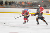 Baldwinsville Bees Jamey Natoli (25) passes the puck against the Rome Free Academy Black Knights in NYSPHSAA Section III Boys Ice hockey action at John F. Kennedy Civic Arena in Rome, New York on Tuesday, January 15, 2019. Rome Free Academy won 4-1.