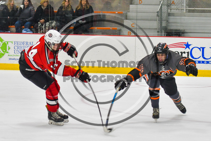 Baldwinsville Bees Nick Glamos (14) has his shot blocked by Rome Free Academy Black Knights Danny Mecca (22) in NYSPHSAA Section III Boys Ice hockey action at John F. Kennedy Civic Arena in Rome, New York on Tuesday, January 15, 2019. Rome Free Academy won 4-1.