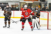 Baldwinsville Bees Nick Glamos (14) sets up between Rome Free Academy Black Knights goalie <br /> Isaiah Nebush (30) and Aaron Russell (18) during a Power Play in NYSPHSAA Section III Boys Ice hockey action at John F. Kennedy Civic Arena in Rome, New York on Tuesday, January 15, 2019. Rome Free Academy won 4-1.