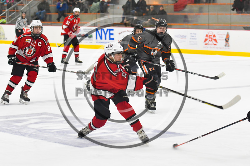 Baldwinsville Bees Michael Carni (6) after taking a shot at the Rome Free Academy Black Knights net in NYSPHSAA Section III Boys Ice hockey action at John F. Kennedy Civic Arena in Rome, New York on Tuesday, January 15, 2019. Rome Free Academy won 4-1.