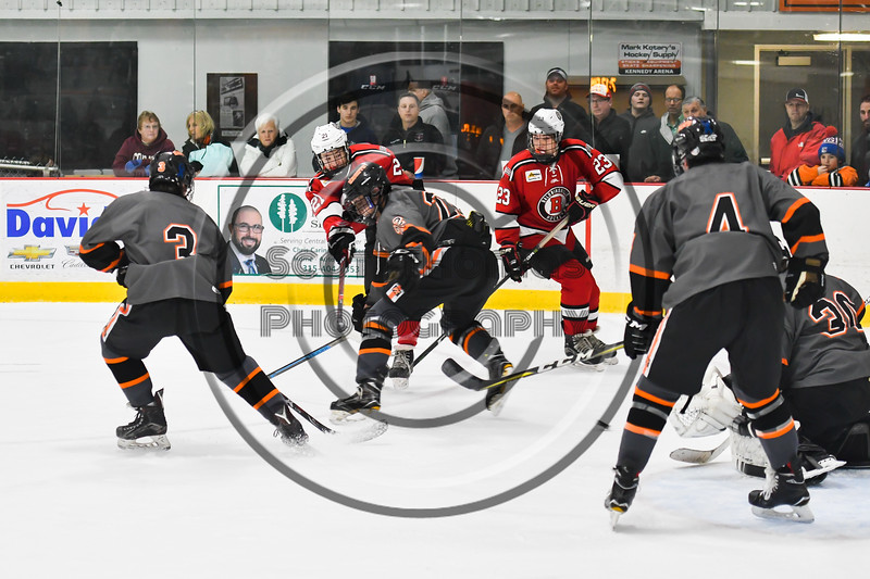 Baldwinsville Bees Cameron Sweeney (21) fires the puck at the Rome Free Academy Black Knights net in NYSPHSAA Section III Boys Ice hockey action at John F. Kennedy Civic Arena in Rome, New York on Tuesday, January 15, 2019. Rome Free Academy won 4-1.