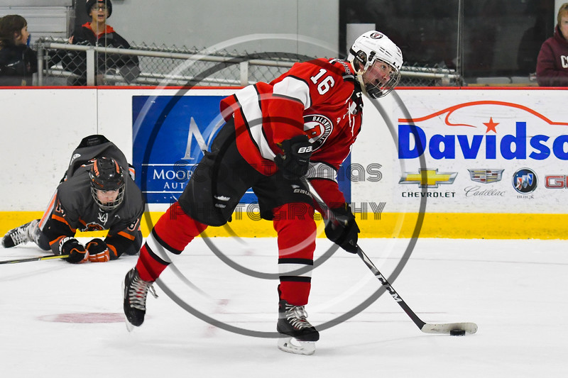 Baldwinsville Bees Luke Hoskin (16) lining up a shot at the Rome Free Academy Black Knights net in NYSPHSAA Section III Boys Ice hockey action at John F. Kennedy Civic Arena in Rome, New York on Tuesday, January 15, 2019. Rome Free Academy won 4-1.