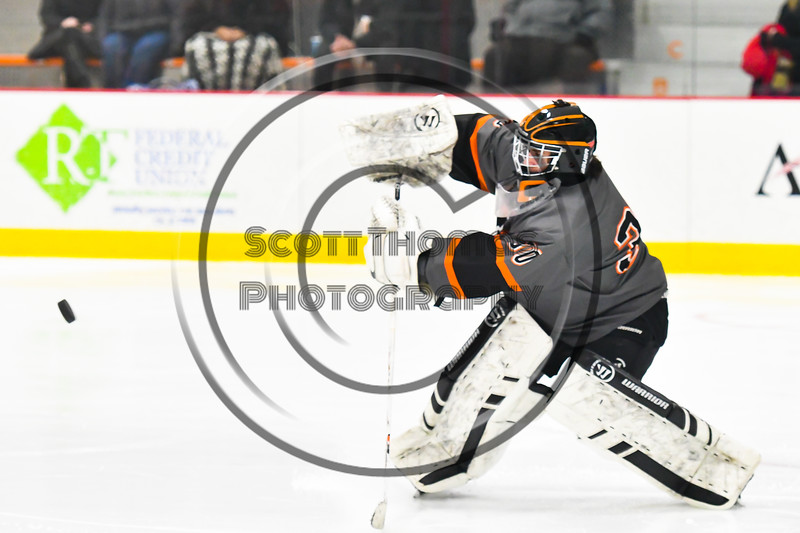 Rome Free Academy Black Knights goalie Isaiah Nebush (30 clears the puck up ice against the Baldwinsville Bees in NYSPHSAA Section III Boys Ice hockey action at John F. Kennedy Civic Arena in Rome, New York on Tuesday, January 15, 2019. Rome Free Academy won 4-1.