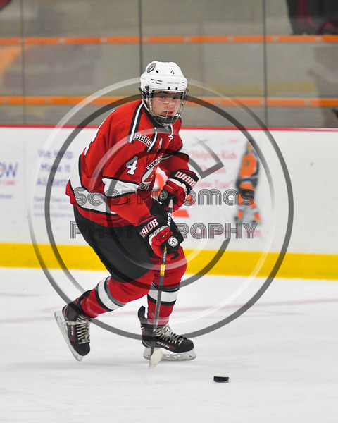 Baldwinsville Bees Quinn Sweeney (4) with the puck against the Rome Free Academy Black Knights in NYSPHSAA Section III Boys Ice hockey action at John F. Kennedy Civic Arena in Rome, New York on Tuesday, January 15, 2019. Rome Free Academy won 4-1.