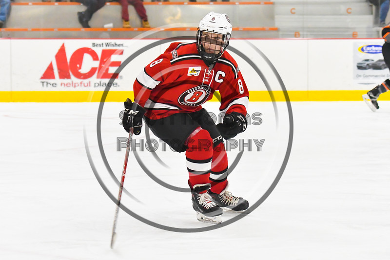Baldwinsville Bees Parker Schroeder (8) skating against the Rome Free Academy Black Knights in NYSPHSAA Section III Boys Ice hockey action at John F. Kennedy Civic Arena in Rome, New York on Tuesday, January 15, 2019. Rome Free Academy won 4-1.