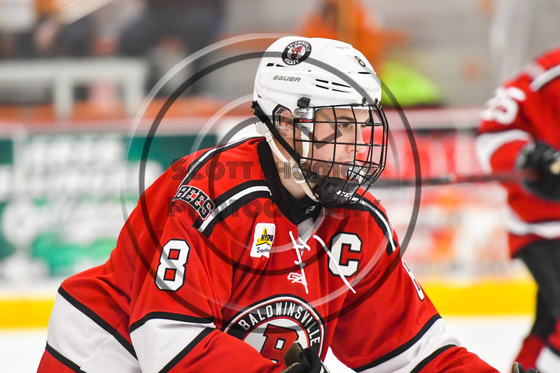 Baldwinsville Bees Parker Schroeder (8) on the ice against the Rome Free Academy Black Knights in NYSPHSAA Section III Boys Ice hockey action at John F. Kennedy Civic Arena in Rome, New York on Tuesday, January 15, 2019. Rome Free Academy won 4-1.