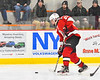 Baldwinsville Bees Braden Lynch (23) comes over the Blue Line and fires the puck at the Rome Free Academy Black Knights net in NYSPHSAA Section III Boys Ice hockey action at John F. Kennedy Civic Arena in Rome, New York on Tuesday, January 15, 2019. Rome Free Academy won 4-1.