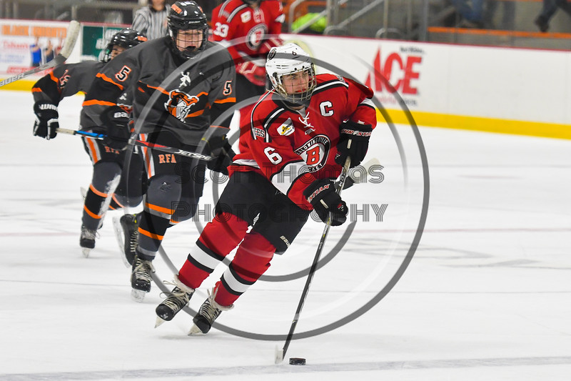 Baldwinsville Bees Michael Carni (6) skating with the puck against the Rome Free Academy Black Knights in NYSPHSAA Section III Boys Ice hockey action at John F. Kennedy Civic Arena in Rome, New York on Tuesday, January 15, 2019. Rome Free Academy won 4-1.