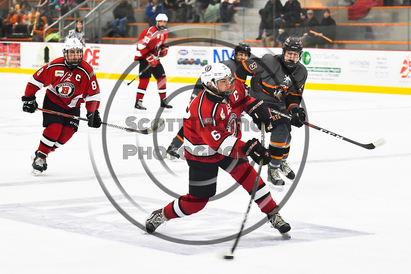 Baldwinsville Bees Michael Carni (6) leans into a shot at the Rome Free Academy Black Knights net in NYSPHSAA Section III Boys Ice hockey action at John F. Kennedy Civic Arena in Rome, New York on Tuesday, January 15, 2019. Rome Free Academy won 4-1.