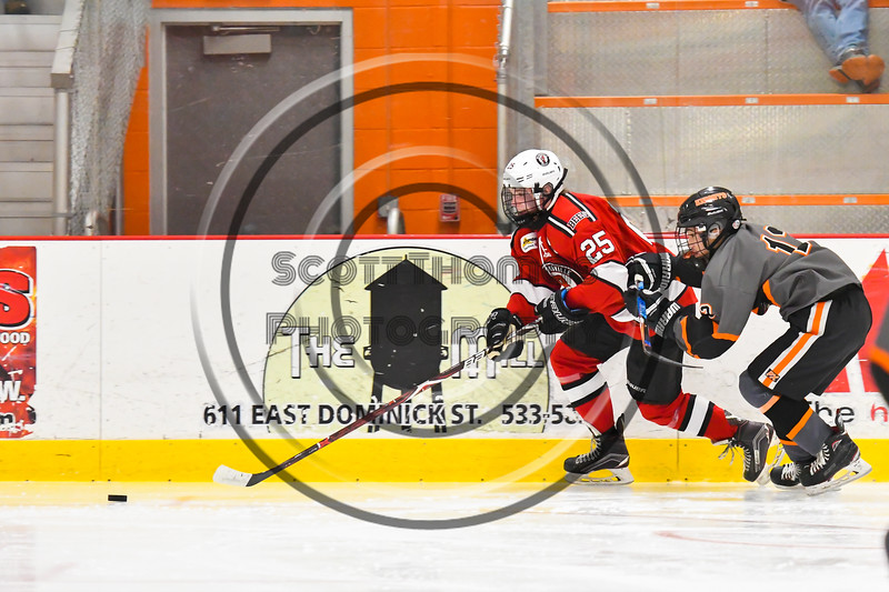 Baldwinsville Bees Braden Lynch (23) skates after the puck against the Rome Free Academy Black Knights in NYSPHSAA Section III Boys Ice hockey action at John F. Kennedy Civic Arena in Rome, New York on Tuesday, January 15, 2019. Rome Free Academy won 4-1.