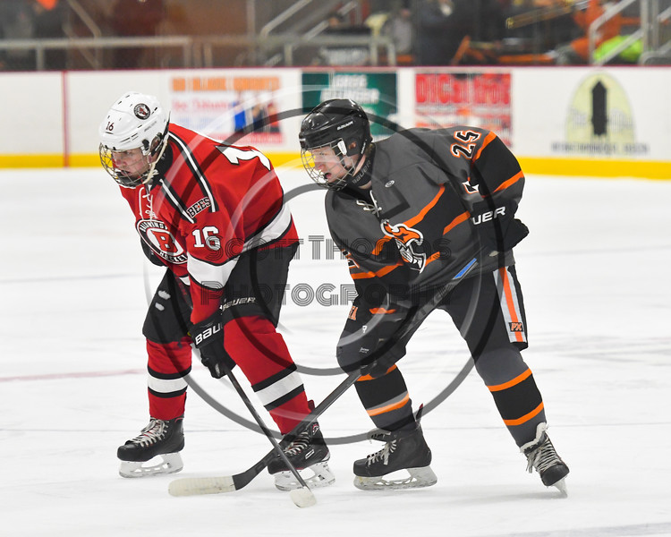 Baldwinsville Bees Luke Hoskin (16) and Rome Free Academy Black Knights Eli Dormino (25) before a face-off in NYSPHSAA Section III Boys Ice hockey action at John F. Kennedy Civic Arena in Rome, New York on Tuesday, January 15, 2019. Rome Free Academy won 4-1.